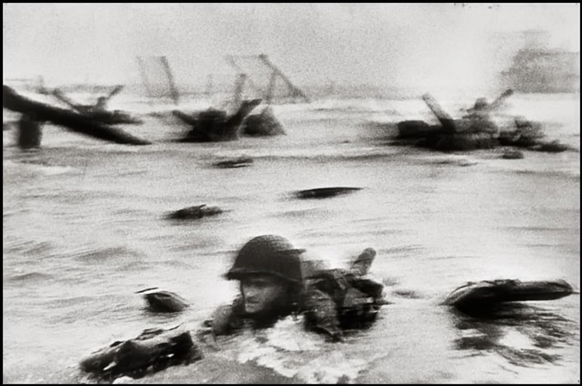 robert_capa-american_soldier_landing_on_omaha_beach-d.day_1944-2